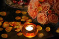 Burning candles roses and petals Royalty Free Stock Photos