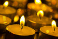 Burning candles with shallow depth of field many Stock Image