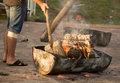 Burning charcoal from wood in a barbecue boiler Royalty Free Stock Photo