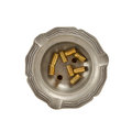 Burning cigarette and empty 9mm bullet casings in an old tin ash Stock Photos