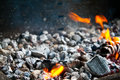 Burning coals in the ash and embers of bonfire after barbecue cooking Stock Photography