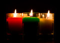 Burning colored candles in the room Royalty Free Stock Photo