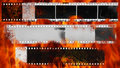 Burning and damaged strip of celluloid film Royalty Free Stock Photo