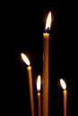 Burning in the dark taper candles Royalty Free Stock Photo