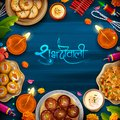 Burning diya with assorted sweet and snack on Happy Diwali Holiday background for light festival of India