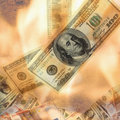 Burning dollar bill as a symbol of inflation and the financial crisis Stock Images