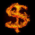 Burning dollar sign Stock Images