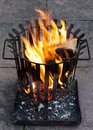 Burning fire basket Royalty Free Stock Image