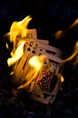 Burning full house hot hand of cards bursting into flames Stock Photos