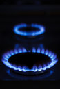 Burning gas cooker rings Stock Photo