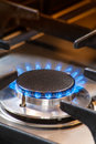 Burning gas stove with blue flames Royalty Free Stock Photos