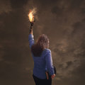 Burning hand with Bible Royalty Free Stock Photo