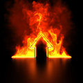 Burning house shape metaphor Stock Image