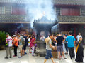Burning incense and praying Royalty Free Stock Photo