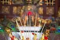 Burning incense sticks in brass bowl in chinese temple Stock Photography