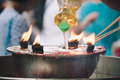 Burning Joss stick and oil palm candle at chinese shrine for mak Royalty Free Stock Photo