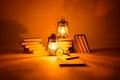 Burning kerosene lamps and books concept magic of light on background Royalty Free Stock Image