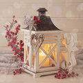 Burning lantern and christmas decoration on white background Stock Image