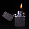 Burning lighter black gasoline with flame on dark background Royalty Free Stock Photos
