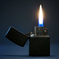 Burning lighter black gasoline with flame on dark background Stock Image