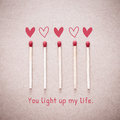 Burning love match with heart shape fire light with wording You light up my life valentine card Royalty Free Stock Photo