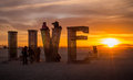 Burning man festival early morning panorama live life as it comes beautiful sunrise in the sands of the black rock desert Royalty Free Stock Photos