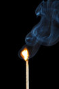 Burning matchstick on black background is isolated Royalty Free Stock Image