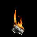 Burning money Royalty Free Stock Photo