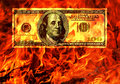 Burning money in flame of fire. Conceptual.