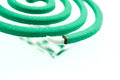 Burning mosquito coil as anti insect smoke spiral usable against mosquitoes and other insects Stock Photo