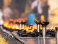 Burning oil lamps at the shwedagon pagoda in yangon capital of republic of union of myanmar shallow depth of field Stock Photography