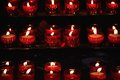 Burning red candles in a church Royalty Free Stock Photo