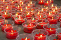 Burning red flower candle at chinese shrine for making merit in Royalty Free Stock Photo