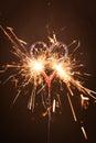 Burning sparkler in heart shape Royalty Free Stock Photo