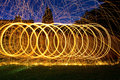 Burning steel wool spin in circles to make patterns the night Royalty Free Stock Photo