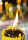 Burning yellow candle Royalty Free Stock Photo
