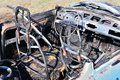Burnt car wreck in accident interior of Stock Photo