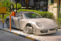 A burnt down convertible porsche boxster expensive possibly due to overheating in an affluent neighborhood Royalty Free Stock Photos