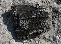 Burnt firewood a piece of on the ashes Royalty Free Stock Photo