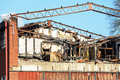 Burnt industrial building a small has down the roof is gone and some of the metal roof beams has been bent by the heat Stock Photography