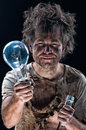 Burnt man with light bulb Royalty Free Stock Photo