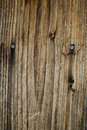 Burnt wood with nails Royalty Free Stock Photos