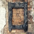 Burnt wooden frame on old brick wall Royalty Free Stock Photo