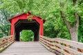 Burr arch covered bridge historic over sugar creek in illinois Royalty Free Stock Photo