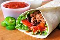 Burrito close up of a filled with meat and vegetables Stock Image