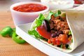 Burrito close up of a on a plate filled with meat and vegetables Royalty Free Stock Photo