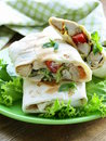 Burrito doner with chicken and vegetables wrapped in pita bread Stock Photography