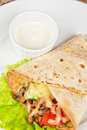 Burrito with meat cheese and vegetables Stock Image