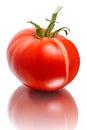 Bursting of the tomato on white isolated background Stock Photo