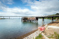 Burton ferry in wales an old wooden jetty on the river cleddau at the village of a small village on the opposite shore from Stock Photos